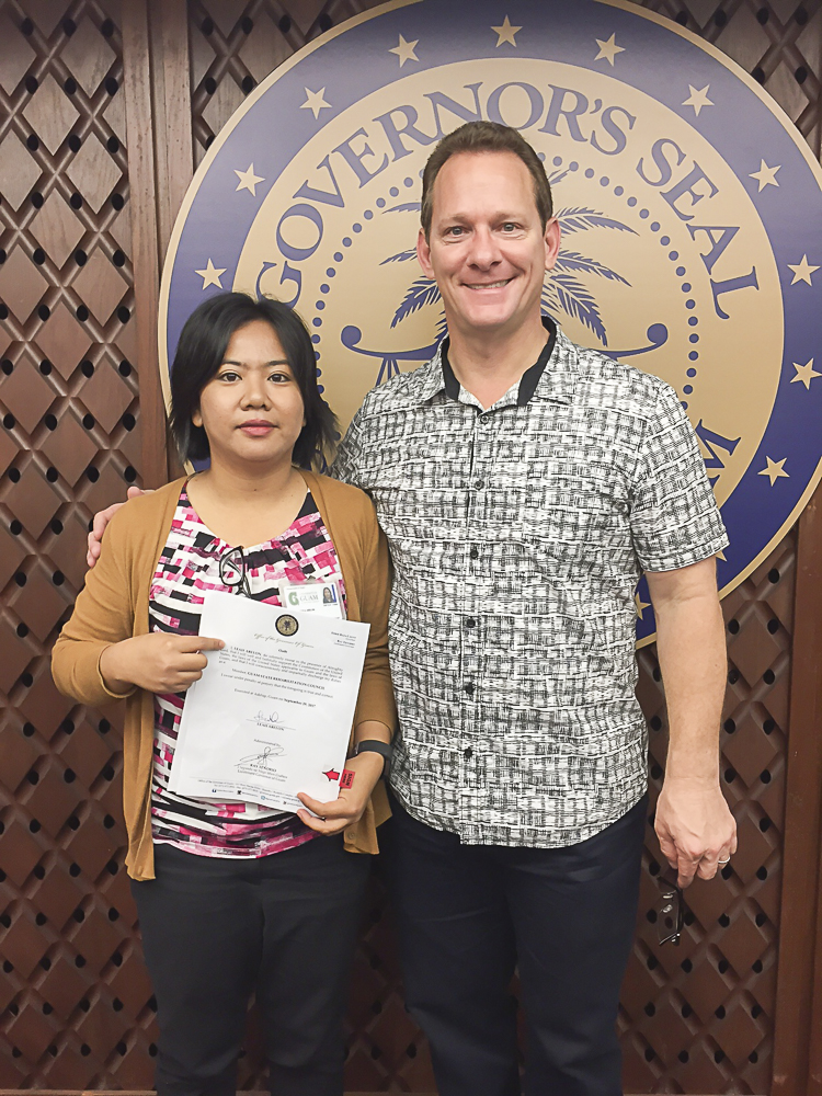 Leah Abelon (left), GSAT Center Coordinator, and Acting Governor of Guam Ray Tenorio (right)